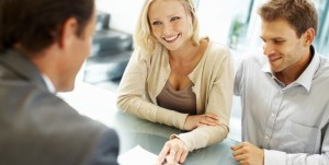stock-photo-16733141-beautiful-business-woman-smiling-in-a-meeting-e1333110398790